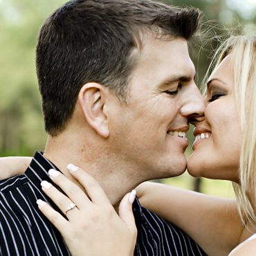 A couple initiating a kiss.