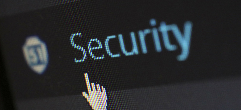 A graphics image with an icon pointing towards security.